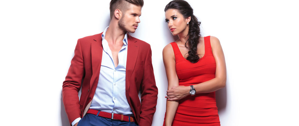 Man and Woman Wearing Designer Clothing